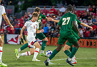 COLLEGE PARK, MD - SEPTEMBER 3: Maryland University forward Hunter George (7) dribbles past George Mason University forward Miles Montgomery (28) during a game between George Mason University and University of Maryland at Ludwig Field on September 3, 2021 in College Park, Maryland.