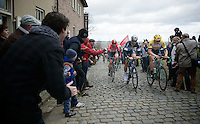 Tom Boonen (BEL/Etixx-QuickStep), Sep Vanmarcke (BEL/LottoNL-Jumbo) & Kris Boeckmans (BEL/Lotto-Soudal) at the front of the peloton, cheered over the Oude Kwaremont<br /> <br /> 67th Kuurne-Brussels-Kuurne 2015