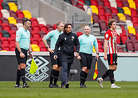 20th March 2021; Brentford Community Stadium, London, England; English Football League Championship Football, Brentford FC versus Nottingham Forest; A disappointed Brentford Manager Thomas Frank walking back towards the tunnel joined by Mads Bech Sorensen of Brentford and Referee Graham Scott and his assistants