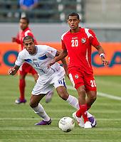 CARSON, CA - March 23, 2012: Eddie Hernandez (13) of Honduras and Anibal Godoy (20) of Panama during the Honduras vs Panama match at the Home Depot Center in Carson, California. Final score Honduras 3, Panama 1.