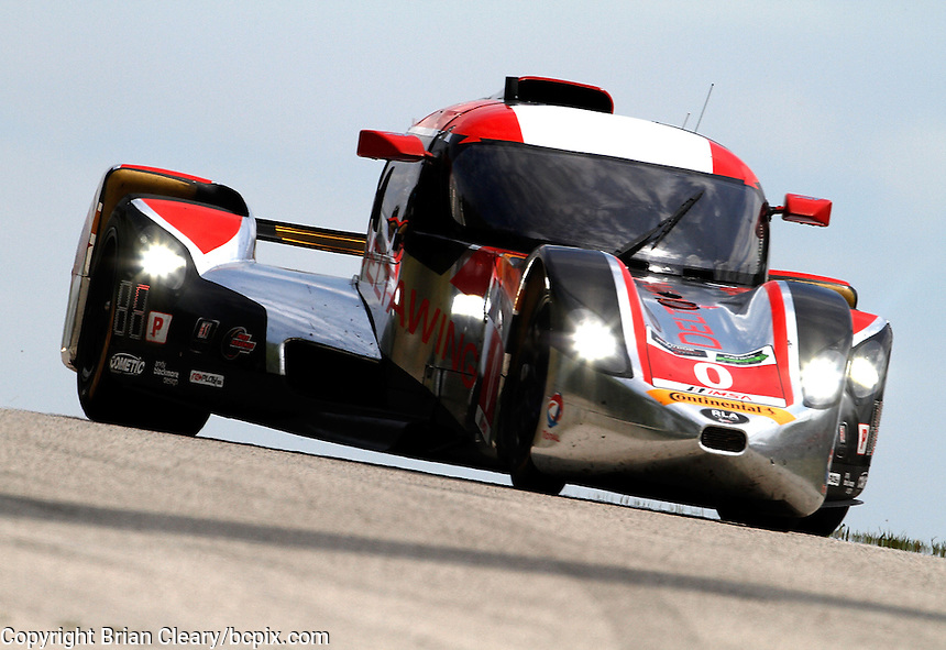 #0 DeltaWing racer of Katherine Legge and Andy Meyrick, IMSA Tudor Series Race, Road America, Elkhart Lake, WI, August 2014.  (Photo by Brian Cleary/ www.bcpix.com )