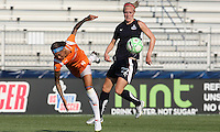 Sky Blue forward, Natasha Kai (6) goes flying as she battles Freedom defender, Becky Sauerbrunn (22) in the box.  Sky Blue defeated the Freedom 2-1 in the first WPS playoff game at the Soccerplex in Boyds, Maryland.