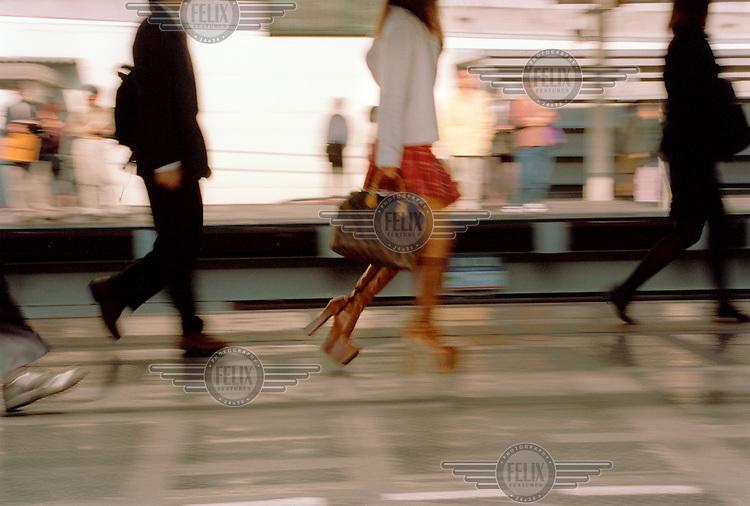 Commuters on a train platform.