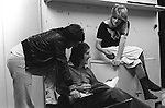 """Paul and Linda McCartney Wings Tour  1975. Paul, Linda and Denny Laine enjoying a joke rehearsal dressing room Elstree, London, England. The photographs from this set were taken in 1975. I was on tour with them for a children's """"Fact Book"""". This book was called, The Facts about a Pop Group Featuring Wings. Introduced by Paul McCartney, published by G.Whizzard. They had recently recorded albums, Wildlife, Red Rose Speedway, Band on the Run and Venus and Mars. I believe it was the English leg of Wings Over the World tour. But as I recall they were promoting,  Band on the Run and Venus and Mars in particular."""