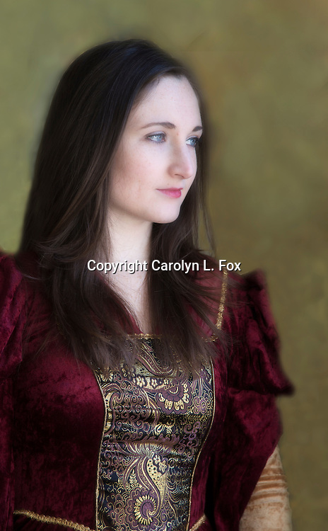 A young woman wearing a burgundy medieval dress stands in front of a green background.