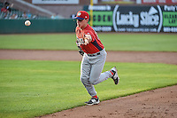 Jeff Boehm (20) of the Orem Owlz flips the ball to first base on defense against the Ogden Raptors in Pioneer League action at Lindquist Field on June 18, 2015 in Ogden, Utah.  This was Opening Night play of the 2015 Pioneer League season. (Stephen Smith/Four Seam Images)