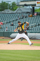 Cam Bedrosian (30) of the Salt Lake Bees delivers a pitch to the plate against the Tacoma Rainiers in Pacific Coast League action at Smith's Ballpark on May 7, 2015 in Salt Lake City, Utah.  (Stephen Smith/Four Seam Images)