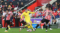 Andrew Robertson of Liverpool bursts through the Brentford defence during Brentford vs Liverpool, Premier League Football at the Brentford Community Stadium on 25th September 2021
