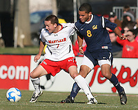 Casey Townsend #7 of the University of Maryland pushes the ball away from Ted Jones #8 of the University of California during an NCAA championship round of sixteen soccer match at Ludwig Field, on November 29, 2008 in College Park, Maryland. The match was won by Maryland 2-1