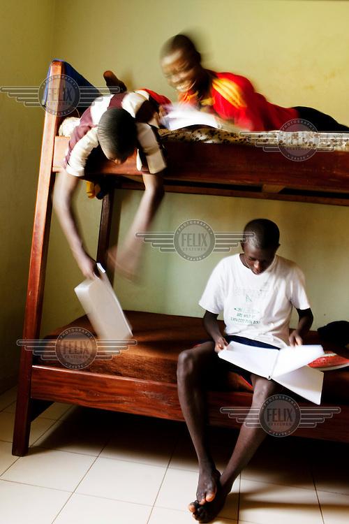 Boys do their homework in the dormitory at the JMG football academy in Bamako.