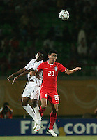 The United States' Sheanon Williams (4) competes for a header against South Korea's Hee Seong Park (20) during the FIFA Under 20 World Cup Group C match between the United States and South Korea at the Mubarak Stadium on October 02, 2009 in Suez, Egypt. The US team lost 3-0.