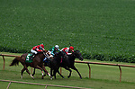 Jockeys, from left, Javier Padron-Barcenas on Kitten Rocks, Gerardo Corrales on Long Monday and Corey J. Lanerle on One Fast Orb compete in the third race at Ellis Park in Henderson, Ky., Sunday afternoon, Aug. 9, 2020. Long Monday won the race with One Fast Orb in second and Kitten Rocks in third.