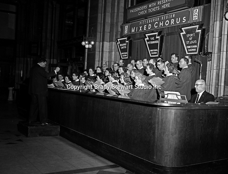 Pittsburgh PA:  During the holidays, the Pennsylvania Railroad's Mixed Chorus performed after work.