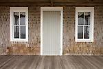 Cottage porch door, windows, and shingles.