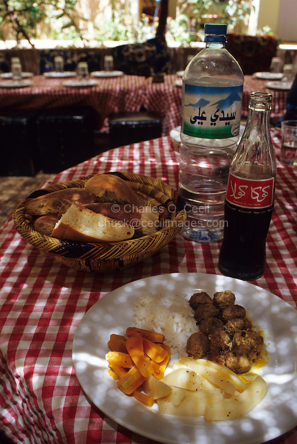 Todra Gorge, Morocco - A Typical Tourist Lunch of Kibbeh (Meat Balls), Potatoes, Rice, Carrots, Bread, Coca Cola, and Bottled Water.