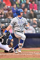 Hartford Yard Goats third baseman Ryan McMahon (13) swings at a pitch during a game against the Richmond Flying Squirrels at The Diamond on April 30, 2016 in Richmond, Virginia. The Yard Goats defeated the Flying Squirrels 5-1. (Tony Farlow/Four Seam Images)