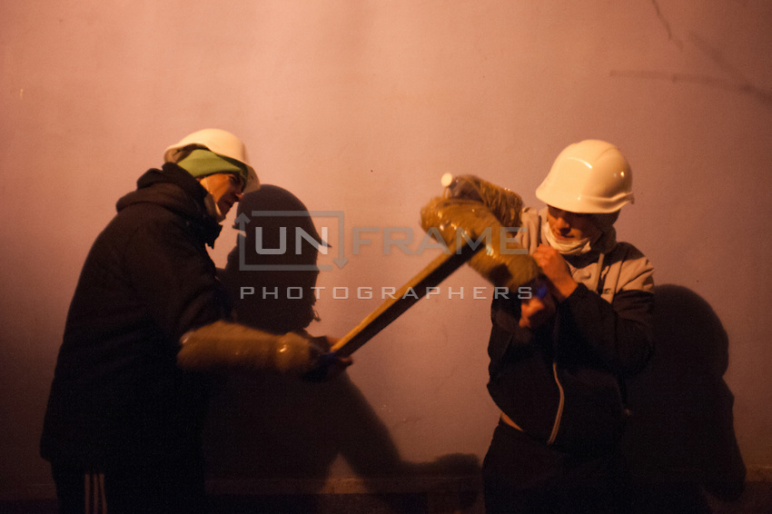Group of young nationalists Preparing protection from rubber bets of riot police. After the violent event when crowd on Independence Square in Kiev was dispersed and more than 30 students were badly hurt, many people expressed their wish to be guards of barricades during nights.