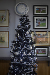 Stafford Rangers 2 Chasetown 1, 26/12/2015. Marston Road, Northern Premier League. Football and military photographs on display behind a Christmas tree at the social club at Marston Road, home of Stafford Rangers before they played local rivals Chasetown in a Northern Premier League first division south fixture. The club has played at Marston Road since 1896 and achieved prominence in the 1970s and 1980s as one of England's top non-League teams. League leaders Stafford won this match 2-1, despite having a man sent off, watched by a season's best attendance of 978. Photo by Colin McPherson.