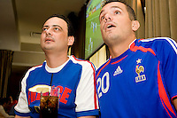 France fans Bruno Benzacken, left, and Michael Athea cheer on their team in their match against Switzerland on June 13, 2006 at Opia, a New York City restaurant.<br /> <br /> The World Cup, held every four years in different locales, is the world's pre-eminent sports tournament in the world's most popular sport, soccer (or football, as most of the world calls it).  Qualification for the World Cup is open to any country with a national team accredited by FIFA, world soccer's governing body. The first World Cup, organized by FIFA in response to the popularity of the first Olympic Games' soccer tournaments, was held in 1930 in Uruguay and was participated in by 13 nations.    <br /> <br /> As of 2010 there are 208 such teams.  The final field of the World Cup is narrowed down to 32 national teams in the three years preceding the tournament, with each region of the world allotted a specific number of spots.  <br /> <br /> The World Cup is the most widely regularly watched event in the world, with soccer teams being a source of national pride.  In most nations, the whole country is at a standstill when their team is playing in the tournament, everyone's eyes glued to their televisions or their ears to the radio, to see if their team will prevail.  While the United States in general is a conspicuous exception to the grip of World Cup fever there is one city that is a rather large exception to that rule.  In New York City, the most diverse city in a nation of immigrants, the melting pot that is America is on full display as fans of all nations gather in all possible venues to watch their teams and celebrate where they have come from.