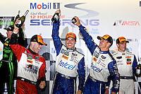 Marino Franchitti, Memo Rojas and Scott Pruett celebrate after winning the 12 Hours of Sebring, Sebring International Raceway, Sebring, FL, March 2014.  (Photo by Brian Cleary/www.bcpix.com)