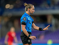 ORLANDO, FL - FEBRUARY 21: Referee Tori Penso talks to a player during a game between Canada and Argentina at Exploria Stadium on February 21, 2021 in Orlando, Florida.