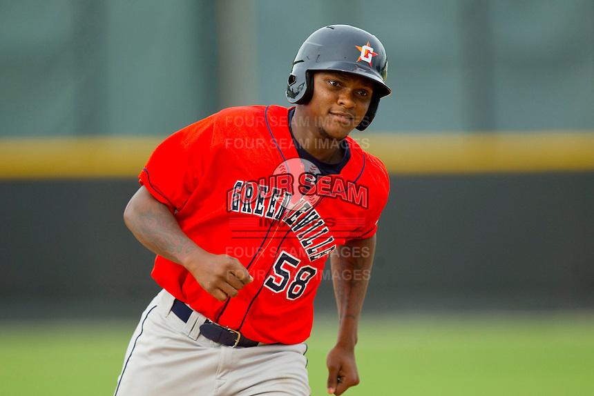 Ariel Ovando (58) of the Greeneville Astros rounds the bases after hitting a home run against the Burlington Royals at Burlington Athletic Park on July 1, 2013 in Burlington, North Carolina.  The Astros defeated the Royals 7-0 in Game One of a doubleheader.  (Brian Westerholt/Four Seam Images)