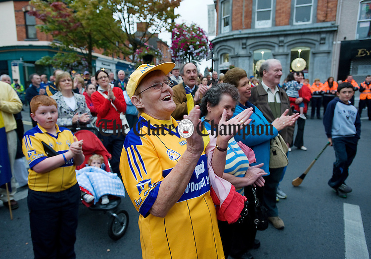 Fan Bridie Murphy of Crusheen applauds her heroes at O Connell square, Ennis, during the homecoming reception for the Clare Intermediate All-Ireland hurling champions. Photograph by John Kelly.