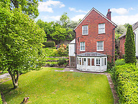 BNPS.co.uk (01202 558833)<br /> Pic: Homesestateagency/BNPS<br /> <br /> Pictured: The lawn of the garden.<br /> <br /> A timewarp home that has been lived in by the same family for more than a century has gone on sale for the first time since being built.<br /> <br /> At the time the property was built, King Edward VII was on the throne and the First World War had not even started.<br /> <br /> The property is being sold for £550,000 under probate by the original builder's three grandchildren, who were born in the Victorian-style house.<br /> <br /> The two-bedroomed home is in the Surrey town of Haslemere and belonged to the Berry family, who decided to sell after the death of their parents, Freda and Leslie.