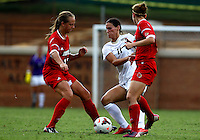 WINSTON-SALEM, NORTH CAROLINA - September 01, 2013:<br /> Erin Yenney (16) and Hannah Konermann (19) of Louisville University stop Rachel Nuzzolese (11) of Wake Forest University during a match at the Wake Forest Invitational tournament at Wake Forest University on September 01. The match was abandoned early in the second half due to severe weather with Wake leading 1-0.