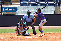 Fort Myers Mighty Mussels batter Misael Urbina (2) awaits the pitch along with catcher Austin Wells (28) and umpire Rainiero Valero during a game against the Tampa Tarpons on May 23, 2021 at George M. Steinbrenner Field in Tampa, Florida.  (Mike Janes/Four Seam Images)