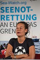 """Pressekonferenz der zivilen Seenotrettungsorganisation Sea-Watch am 2. Juli 2019 in Berlin, nachdem die Kapitaenin des Rettungsschiff """"Sea-Watch 3"""", Carola Rackete, in Italien festgenommen wurde. Die Kapitaenin hatte am 29. Juni gegen den Willen der italienischen Regierung auf der Mittelmeerinsel Lampedusa, mit 40 aus Seenot geretteten Fluechtlingen, im Hafen angelegt und war daraufhin festgenommen worden.<br /> Im Bild: Marie Naass, politische Sprecherin von Sea-Watch.<br /> 2.7.2019, Berlin<br /> Copyright: Christian-Ditsch.de<br /> [Inhaltsveraendernde Manipulation des Fotos nur nach ausdruecklicher Genehmigung des Fotografen. Vereinbarungen ueber Abtretung von Persoenlichkeitsrechten/Model Release der abgebildeten Person/Personen liegen nicht vor. NO MODEL RELEASE! Nur fuer Redaktionelle Zwecke. Don't publish without copyright Christian-Ditsch.de, Veroeffentlichung nur mit Fotografennennung, sowie gegen Honorar, MwSt. und Beleg. Konto: I N G - D i B a, IBAN DE58500105175400192269, BIC INGDDEFFXXX, Kontakt: post@christian-ditsch.de<br /> Bei der Bearbeitung der Dateiinformationen darf die Urheberkennzeichnung in den EXIF- und  IPTC-Daten nicht entfernt werden, diese sind in digitalen Medien nach §95c UrhG rechtlich geschuetzt. Der Urhebervermerk wird gemaess §13 UrhG verlangt.]"""
