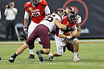 Minnesota Golden Gophers linebacker Mike Rallis (26) tackles Texas Tech Red Raiders quarterback Seth Doege (7) during the Meineke Car Care Bowl game of Texas between the Texas Tech Red Raiders and the Minnesota Golden Gophers at the Reliant Stadium in Houston, Texas. Texas defeats Minnesota 34 to 31.