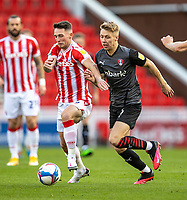 31st October 2020; Bet365 Stadium, Stoke, Staffordshire, England; English Football League Championship Football, Stoke City versus Rotherham United; Jamie Lindsay of Rotherham United tackles Jordan Thompson of Stoke City