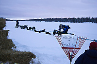 Rohn Buser changes his dogs' postions at the Finger Lake checkpoint during Iditarod 2008