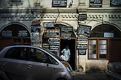 A man walks out of an old colonial building in Central Sri Lanka.  Photo: Sanjit Das/Panos