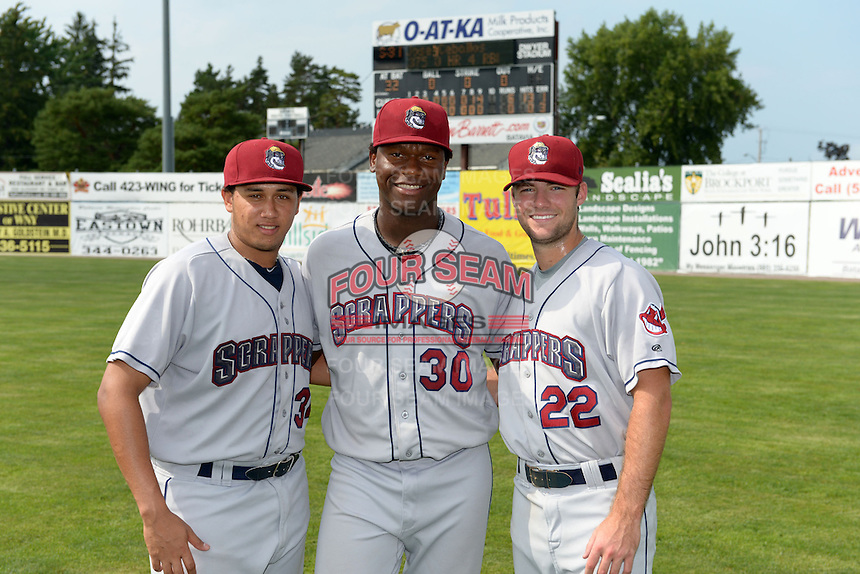 Mahoning Valley Scrappers pitchers Luis Gomez (34), Carlos Melo (30), and Kerry Doane (22) pose for a photo in front of the scoreboard after combining to throw a no-hitter against the Batavia Muckdogs on September 1, 2013 at Dwyer Stadium in Batavia, New York.  Mahoning Valley defeated Batavia 6-0.  (Mike Janes/Four Seam Images)