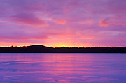 Sunset over Lake Massabesic in Auburn, New Hampshire. Located in Manchester and Auburn, this lake covers over 2,500 acres, and it is the drinking water supply for the Manchester area.