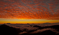 Cloudscape Sunrise: Looking towards sunrise and a cloud pattern, seen from Haleakala in Haleakala National Park, Maui. On the distant right, Mauna Kea on the Big Island of Hawai'i is visible.