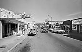 383H-15 Broadway looking east from N. Downing Street, Seaside Variety 88¢ Store, 316 Broadway in foreground, Seaside, Oregon. September 1971.