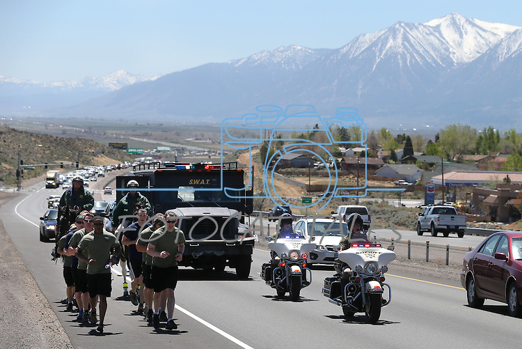 Members of the Carson City Sheriff's Office through Indian Hills, Nev., on Wednesday, May 1, 2013 as part of the 14th annual memorial run between Las Vegas and Carson City. Law enforcement agencies from across the state have participated in the 450-mile run to bring a baton containing the names of 123 Nevada peace officers who were killed in the line of duty to the site of tomorrow's annual Nevada Peace Officers Memorial. <br /> Photo by Cathleen Allison