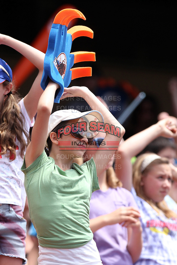 Buffalo Bisons fans dancing during a game against the Columbus Clippers at Coca-Cola Field on May 31, 2012 in Buffalo, New York.  Columbus defeated Buffalo 3-0.  (Mike Janes/Four Seam Images)