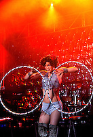 "Professional hoop dance performer Vivian ""Spiral"" Hancock captivates the crowds in downtown Charlotte NC during First Night Charlotte 2010. Spiral Hancock's movement art spins hula-hoops all over her body while contorting and acrobatically flipping through them. Hancock performed on stage during the family-friendly public event (no alcohol allowed) is an annual cultural New Year's Eve celebration held in downtown / uptown / Charlotte center city. Charlotte First Night - An Imagination Celebration brought together artists, musicians, dancers and more from across the country. The New Year's event is organized by Charlotte Center City Partners, which facilitates and promotes the economic and cultural development of this North Carolina urban core."