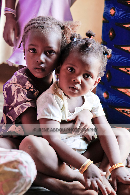Two Fulani girls attend a baptism in Ouagadougou, Burkina Faso.