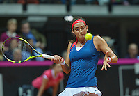Arena Loire,  Trélazé,  France, 16 April, 2016, Semifinal FedCup, France-Netherlands, First match: Kiki Bertens vs Caroline Garcia, Kiki Bertens (NED), Photo: Caroline Garcia in the defence<br /> Photo: Henk Koster/Tennisimages