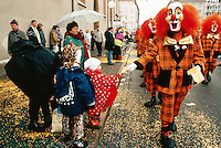 """Switzerland. Basel. Fasnacht Carnival. A group of persons from a  """"clique"""" disguised in clowns walk on the road during the afternoon parade. A """"clique""""  is a group of persons playing music in the streets during the three days of the Fasnacht Carnival. © 1997 Didier Ruef"""