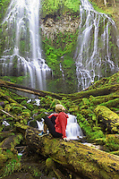 Hiker viewing Upper Proxy Falls. Three Sisters Wilderness, Oregon