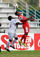 Christopher Nanco (11) of Canada goes up for a header with Aldair Paredes (11) of Panama during the semifinals of the CONCACAF Men's Under 17 Championship at Catherine Hall Stadium in Montego Bay, Jamaica. Canada defeated Panama, 1-0.