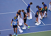 8th September 2021; New York, USA; 2021 US Open Tennis quarter finals; Alexander Zverev , Germany helps the court official to dry the court