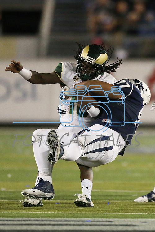 Colorado State's Dee Hart (10) gets tackled by Nevada's Salesa Faraimo (97) during the second half of an NCAA college football game in Reno, Nev., on Saturday, Oct. 11, 2014. (AP Photo/Cathleen Allison)