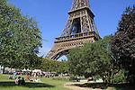 Picnic under the Tour Eiffel or Eiffel Tower in Paris, France.